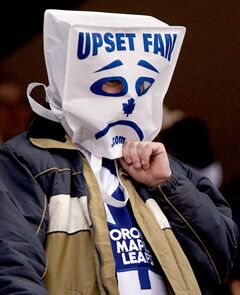 A Toronto Maple Leafs' fan leaves the arena in the final minutes of the Maple Leafs 8-2 loss to Ottawa Senators during NHL hockey action in Toronto, Thursday April 3, 2008. THE CANADIAN PRESS/Adrian Wyld closecut close cut