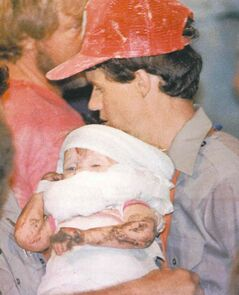 FILE - In this October 1987 file photo, a rescue worker carries 18-month-old Jessica McClure to safety in Midland, Texas, after being trapped for 58 hours after she plunged 22 feet into an abandoned water well. Now married with two children, Jessica McClure Morales turns 25 on March 26 and gains access to a trust fund of up to $800,000, the result of donations from thousands of sympathetic strangers across the globe glued to the television for the 58 hours until she was freed. (AP Photo/Eric Gay, File)
