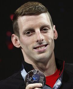 Canada's Ryan Cochrane holds the silver medal that he won in the Men's 1500m freestyle at the FINA Swimming World Championships in Barcelona, Spain, Sunday, Aug. 4, 2013. There are still two years to go before the curtain goes up on the 2016 Summer Olympics, but many of Canada's top athletes are already on the road to Rio and this month's Commonwealth Games are a key stop THE CANADIAN PRESS/AP/Michael Sohn