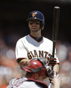San Francisco Giants' Marco Scutaro prepares to bat against the Arizona Diamondbacks in the first inning of a baseball game Saturday, July 12, 2014, in San Francisco. (AP Photo/Ben Margot)