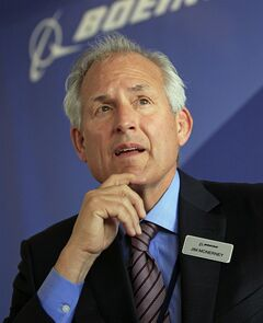 """FILE - This June 18, 2013 file photo shows Boeing Company chairman and chief executive officer Jim McNerney, during a news conference, in Le Bourget, France. McNerney apologized Friday, July 25, 2014, for saying the aerospace giant's employees were """"cowering"""" during his tenure, a comment one union official called """"a new low"""" in the company's relationship with workers. (AP Photo/Remy de la Mauviniere, File)"""