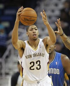 New Orleans Pelicans forward Anthony Davis (23) grabs a loose ball in the second half of an NBA basketball game against the Orlando Magic in New Orleans, Sunday, Jan. 26, 2014. The Pelicans defeated the Magic 100-92. (AP Photo/Bill Haber).