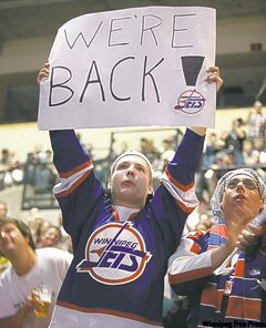Joshua Berthelett's sign  predicts the announcement that was to come at the NHL draft at the MTS Centre in Winnipeg.