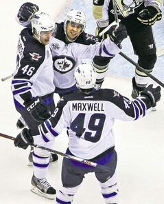 Jets players celebrate a goal against Pittsburgh Penguins.