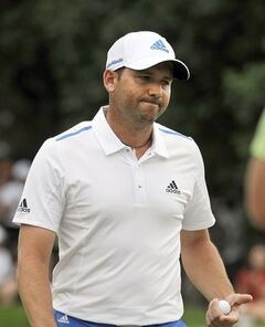 Sergio Garcia, of Spain, reacts after his bogey on the ninth hole during the final round of the Travelers Championship golf tournament in Cromwell, Conn., Sunday, June 22, 2014. (AP Photo/Fred Beckham)