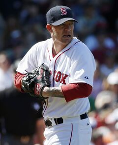 Boston Red Sox's Jake Peavy reacts as he walks back to the mound with bases loaded in the sixth inning of a baseball game against the Baltimore Orioles in Boston, Sunday, July 6, 2014. (AP Photo/Michael Dwyer)