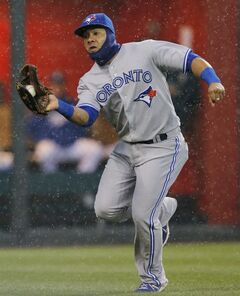 In the rain, Toronto Blue Jays left fielder Melky Cabrera catches a fly ball hit by Kansas City Royals' Eric Hosmer during the first inning of a baseball game at Kauffman Stadium in Kansas City, Mo., Wednesday, April 30, 2014. (AP Photo/Orlin Wagner)