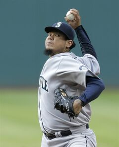 Seattle Mariners starting pitcher Felix Hernandez delivers in the first inning of a baseball game against the Seattle Mariners Wednesday, July 30, 2014, in Cleveland. (AP Photo/Tony Dejak)