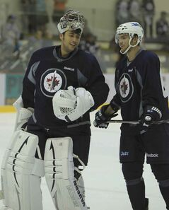 Michael Frolik (right) and Ondrej Pavelec have a long history together, back to their formative years in the Czech Republic.