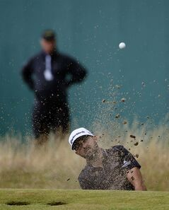 Rhein Gibson of Australia plays out of the bunker on the 18th hole during the third day of the British Open Golf championship at the Royal Liverpool golf club, Hoylake, England, Saturday July 19, 2014. (AP Photo/Alastair Grant)