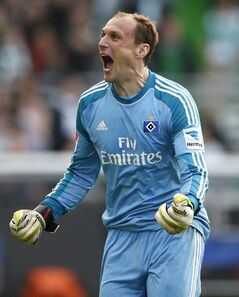 Hamburg goalkeeper Jaroslav Drobny of Czech Republic celebrates after winning relegation play-offs between Greuther Fuerth and Hamburger SV in Fuerth, Germany, Sunday, May 18, 2014. Hamburg played 1-1 in Fuerth and remains in the first division . (AP Photo/Matthias Schrader)