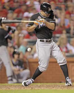 Miami Marlins' Reed Johnson is hit by a pitch from St. Louis Cardinals relief pitcher Trevor Rosenthal in the ninth inning of a baseball game on Friday, July 4, 2014, in St. Louis. The Cardinals won 3-2. (AP Photo/Tom Gannam)