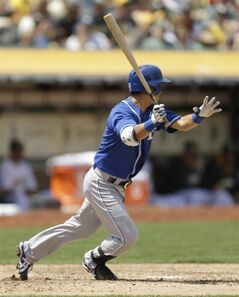 Kansas City Royals' Norichika Aoki of Japan swings for an RBI double off Oakland Athletics Scott Kazmir in the fifth inning of a baseball game Sunday, Aug. 3, 2014, in Oakland, Calif. (AP Photo/Ben Margot)