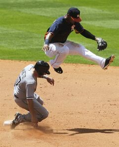 Houston Astros shortstop Jonathan Villar leaps over Chicago White Sox's Adrian Nieto for an out in the fifth inning of a baseball game, Sunday, May 18, 2014, in Houston. (AP Photo/Patric Schneider)