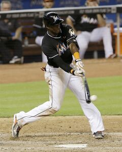 Miami Marlins' Adeiny Hechavarria hits a single against the Pittsburgh Pirates in the ninth inning of a baseball game in Miami, Saturday, June 14, 2014. The Pirates won 8-6. (AP Photo/Alan Diaz)