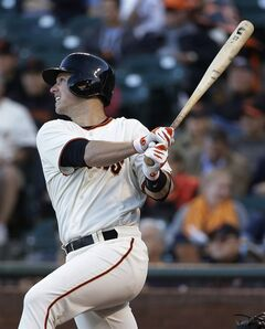 San Francisco Giants' Buster Posey doubles to right field off Cincinnati Reds starting pitcher Mike Leake in the first inning of their baseball game Thursday, June 26, 2014, in San Francisco. (AP Photo/Eric Risberg)
