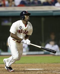 Cleveland Indians' Michael Bourn watches his ball after hitting a double off Kansas City Royals starting pitcher Yordano Ventura in the eighth inning of a baseball game on Friday, July 4, 2014, in Cleveland. (AP Photo/Tony Dejak)