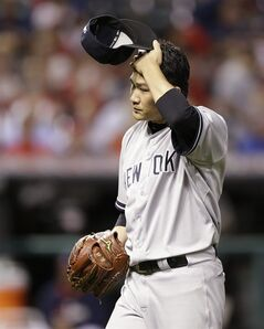 New York Yankees starting pitcher Masahiro Tanaka walks to the dugout in the seventh inning of a baseball game against the Cleveland Indians Tuesday, July 8, 2014, in Cleveland. Tanaka pitched 6 2/3 innings and gave up 10 hits and five runs. (AP Photo/Tony Dejak)