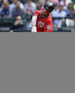 Washington Nationals' Bryce Harper hits a solo home run in the fourth inning of a baseball game against the Seattle Mariners, Sunday, Aug. 31, 2014, in Seattle. Harper also hit a solo home run in the second inning. (AP Photo/Ted S. Warren)