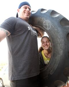 For Jesse Cox, with his daughter Angelica, lifting a tractor tire is all a day's training for the 2014 PEAK Death Race.