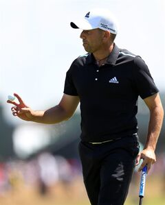 Sergio Garcia of Spain holds up his ball after saving par on the 17th hole during the first day of the British Open Golf championship at the Royal Liverpool golf club, Hoylake, England, Thursday July 17, 2014. (AP Photo/Scott Heppell)