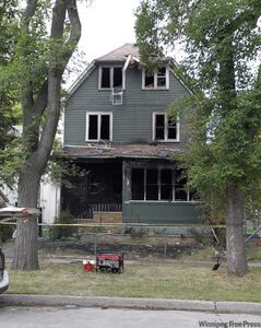The remains of a rooming house on Austin Street North where the fire killed five people.
