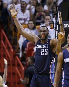 Charlotte Bobcats' Al Jefferson (25) reacts after being charged with a foul during the second half in Game 2 of an opening-round NBA basketball playoff series against the Miami Heat, Wednesday, April 23, 2014, in Miami. The Heat defeated the Bobcats 101-97 and took a 2-0 lead in the series. (AP Photo/Lynne Sladky)