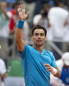 Italy's Fabio Fognini celebrates defeating Argentina's Juan Monaco 7-5, 6-2, 6-2 at their Davis Cup singles tennis match in Mar del Plata, Argentina, Friday, Jan. 31, 2014. (AP Photo/Eduardo Di Baia)