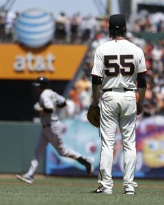 San Francisco Giants pitcher Tim Lincecum (55) waits for Pittsburgh Pirates' Jordy Mercer to run the bases after Mercer's two run home in the fifth inning of a baseball game Wednesday, July 30, 2014, in San Francisco. (AP Photo/Ben Margot)