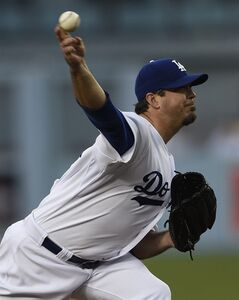 Los Angeles Dodgers starting pitcher Josh Beckett pitches during the first inning of a baseball game against the San Francisco Giants in Los Angeles, Thursday, May 8, 2014. (AP Photo/Kelvin Kuo)