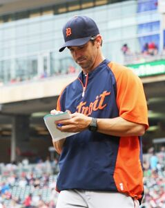 Detroit Tigers manager Brad Ausmus returns to the dugout after a lineup change in the ninth inning of a baseball game against the Minnesota Twins, Saturday, Aug. 23, 2014, in Minneapolis. The Twins won the game, the first of a doubleheader, 12-4. (AP Photo/Jim Mone)