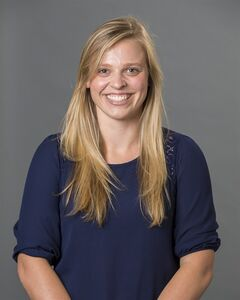 This 2013 photo provided by the University of Richmond shows director of basketball operations Natalie Lewis. Lewis and associate head coach Ginny Doyle were two of the three people aboard a hot air balloon that drifted into a power line, burst into flames and crashed on Friday, May 9, 2014, in Virginia. Investigators say their remains were found about a mile apart in dense woods. (AP Photo/University of Richmond, Frank Strauss)