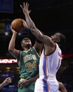 Boston Celtics forward Paul Pierce (34) shoots as Oklahoma City Thunder center Kendrick Perkins (5) defends in the second quarter of an NBA basketball game in Oklahoma City, Sunday, March 10, 2013. (AP Photo/Sue Ogrocki)