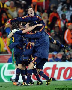 Spanish soccer players get close to celebrate a victory.