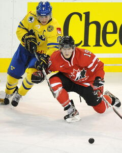 The Jets' Mark Scheifele (right), seen here taking on Sweden's Johan Larsson at the 2012 world junior tournament, is adding to his international experience.