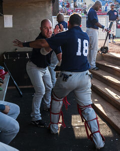 Veteran Jon Weber and catcher Luis Alen perform a handshake before the start of the Saturday game in Sioux City.