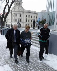Peter and Judith Chernecki, with lawyer Jay Prober (left), leave court Tuesday after pleading guilty to animal-care violations.