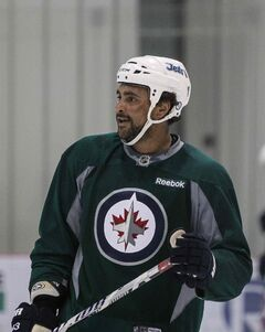 Winnipeg Jets' Dustin Byfuglien (33) hits the ice for the first practice after the Olympic break at the MTS IcePlex Wednesday afternoon.