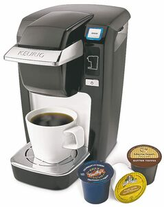 Keurig Mini Plus single-serve coffee maker with pods.
