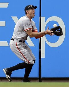 San Francisco Giants right fielder Hunter Pence catches a ball hit by St. Louis Cardinals' Yadier Molina for an out during the fifth inning of a baseball game Saturday, May 31, 2014, in St. Louis. The Cardinals won 2-0. (AP Photo/Jeff Roberson)