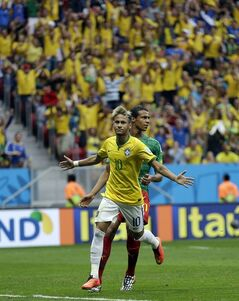 Brazil's Neymar runs past Cameroon's Joel Matip after scoring his side's first goal during the group A World Cup soccer match between Cameroon and Brazil at the Estadio Nacional in Brasilia, Brazil, Monday, June 23, 2014. (AP Photo/Natacha Pisarenko)