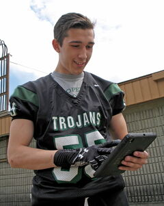 Noah Wilson and the rest of the Vincent Massey Trojans will be trading their paper playbooks for iPad Minis during the upcoming football season.