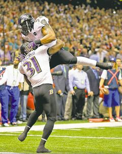 Ravens linebacker Ray Lewis and safety Bernard Pollard (31) celebrate an incomplete pass thrown by 49ers quarterback Colin Kaepernick in the second half of Super Bowl XLVII in New Orleans on Sunday.