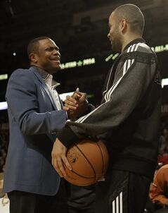 Actor Chris Tucker, left and West Team's Tony Parker, of the San Antonio Spurs speak before the NBA All Star basketball game, Sunday, Feb. 16, 2014, in New Orleans. (AP Photo/Gerald Herbert)
