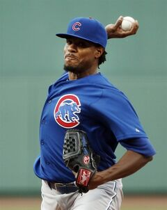 Chicago Cubs starting pitcher Edwin Jackson delivers to the Boston Red Sox in the first inning of a baseball game at Fenway Park in Boston, Tuesday, July 1, 2014. (AP Photo/Elise Amendola)