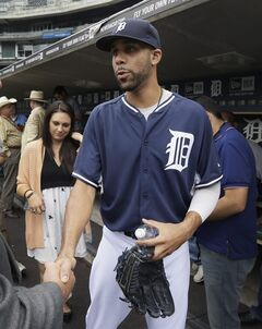 Detroit Tigers starting pitcher David Price is introduced to the media before an interleague baseball game against the Colorado Rockies, Saturday, Aug. 2, 2014, in Detroit. (AP Photo/Carlos Osorio)