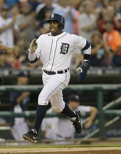 Detroit Tigers' Rajai Davis scores from first on a double by teammate Ian Kinsler during the fifth inning of an interleague baseball game against the Colorado Rockies, Friday, Aug. 1, 2014, in Detroit. (AP Photo/Carlos Osorio)