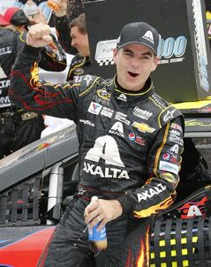 Jeff Gordon celebrates his victory after the NASCAR Sprint Cup Series Pure Michigan 400 auto race at Michigan International Speedway in Brooklyn, Mich., Sunday, Aug. 17, 2014. (AP Photo/Bob Brodbeck)