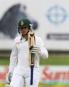 South Africa's batsman Quinton de Kock, walks back to the players pavilion after being dismissed by Australia's Steven Smith, for 7 runs on the first day of their 2nd cricket test match at St George's Park in Port Elizabeth, South Africa, Thursday, Feb. 20, 2014. (AP Photo/ Themba Hadebe)