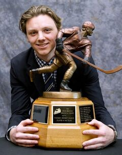 Kootenay Ice's Sam Reinhart poses with his trophy after being named WHL Player of the Year, winning the Four Broncos Memorial Trophy, in Calgary on Wednesdy April 30, 2014. THE CANADIAN PRESS/Larry MacDougal
